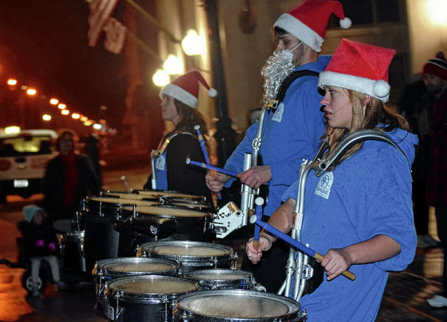 Members of the Jacksonville Drumline Institute march in the Christmas parade Friday. Photo: Samantha McDaniel-Ogletree | Journal-Courier