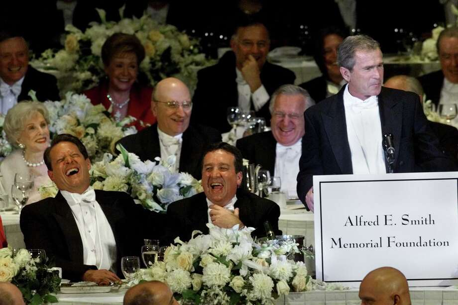 Al Gore, left, shares a light moment with the audience during remarks by George W. Bush during the 2000 Alfred E. Smith Memorial Foundation Dinner, Thursday, Oct. 19, 2000, in New York. At center is Alfred E. Smith IV. Smith died Nov. 20, 2019 at age 68. Photo: Beth Keiser /AP / AP