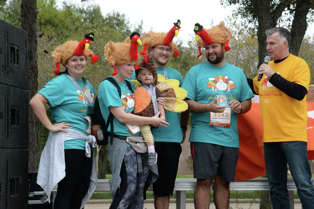 The Frost Family Gobblers are recognized for the best Thanksgiving theme costumes during the YMCA Turkey Dash in Katy, TX on Thursday, November 28, 2019.