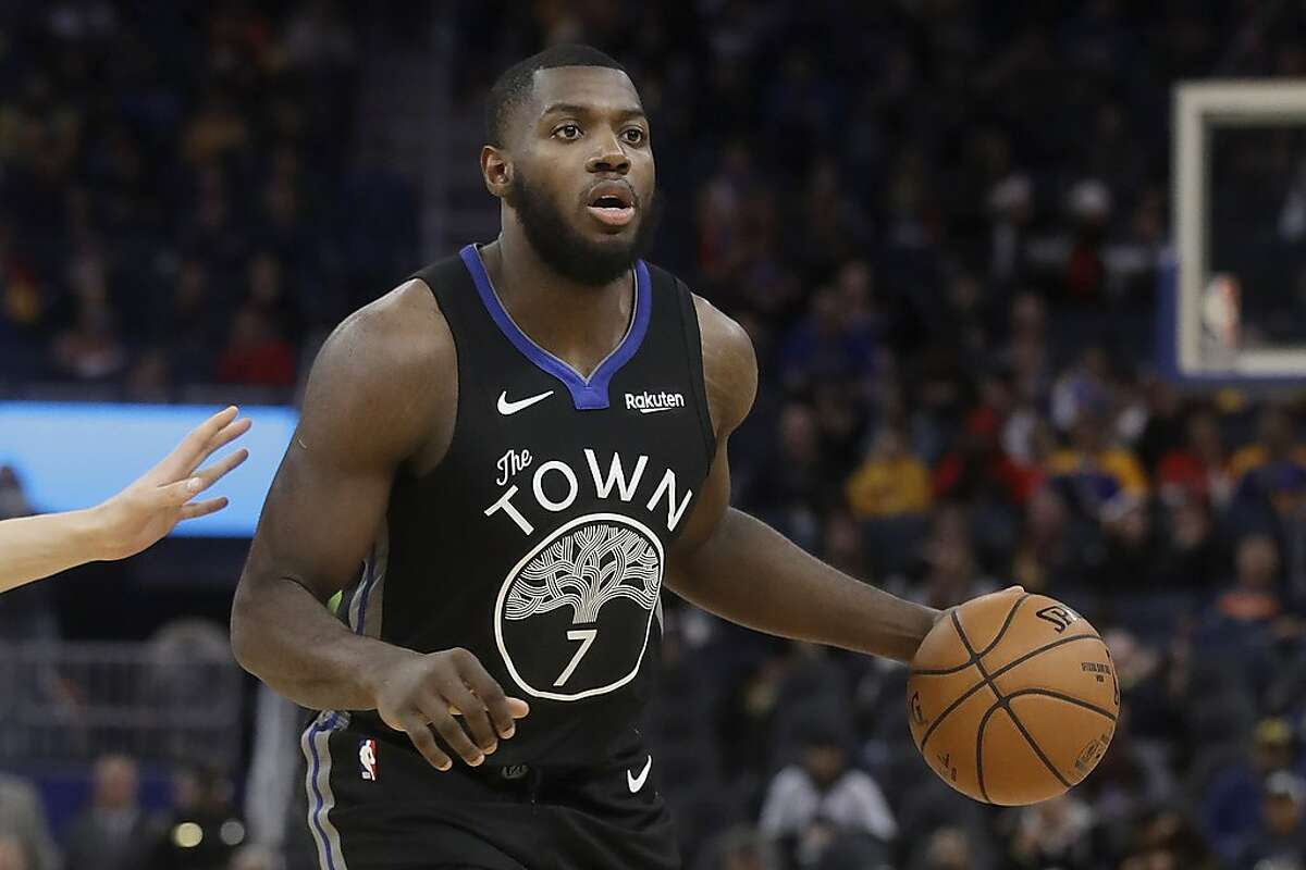 Golden State Warriors forward Eric Paschall brings the ball up against the Chicago Bulls during the second half of an NBA basketball game in San Francisco, Wednesday, Nov. 27, 2019. (AP Photo/Jeff Chiu)