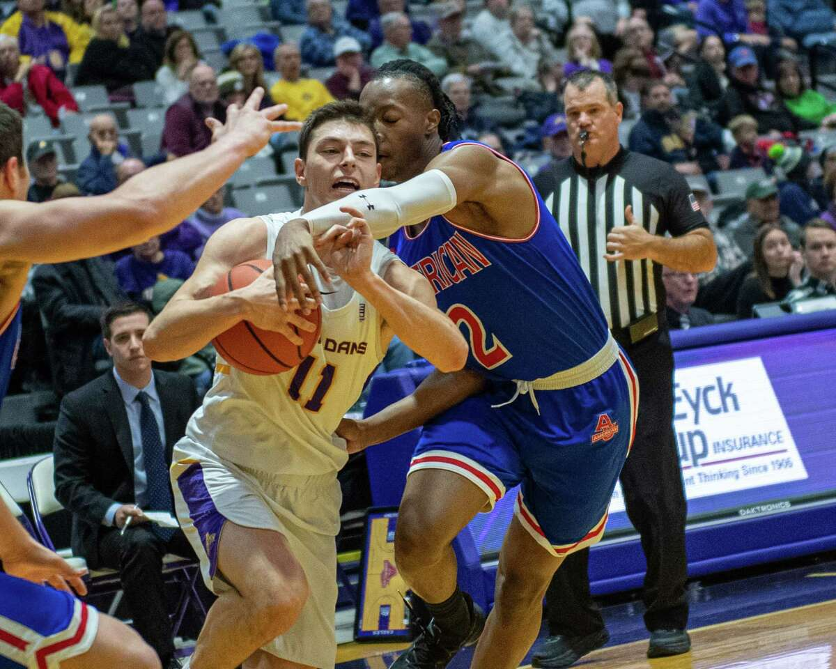 UAlbany guard Cameron Healy drives to the basket in front of American University guard Stacy Beckton Jr. at the SEFCU Arena in Albany, New York on Saturday, Nov. 30, 2019 (Jim Franco/Special to the Times Union.)