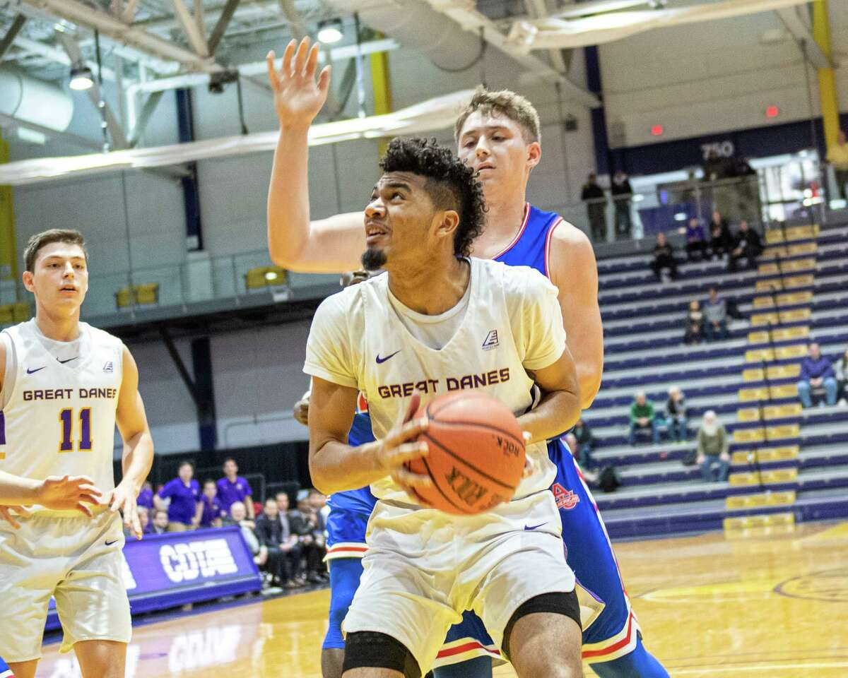 UAlbany forward Malachi De Sousa looks to the basket in front of American University guard Jacob Boonyasith at the SEFCU Arena in Albany, New York on Saturday, Nov. 30, 2019 (Jim Franco/Special to the Times Union.)