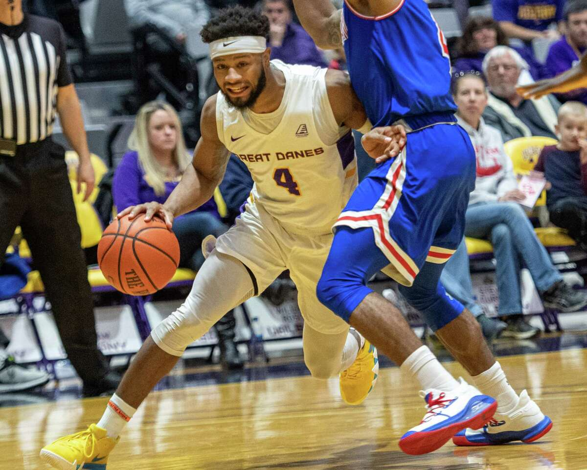 UAlbany guard Ahmad Clark drives by an American University defender at the SEFCU Arena in Albany, New York on Saturday, Nov. 30, 2019 (Jim Franco/Special to the Times Union.)