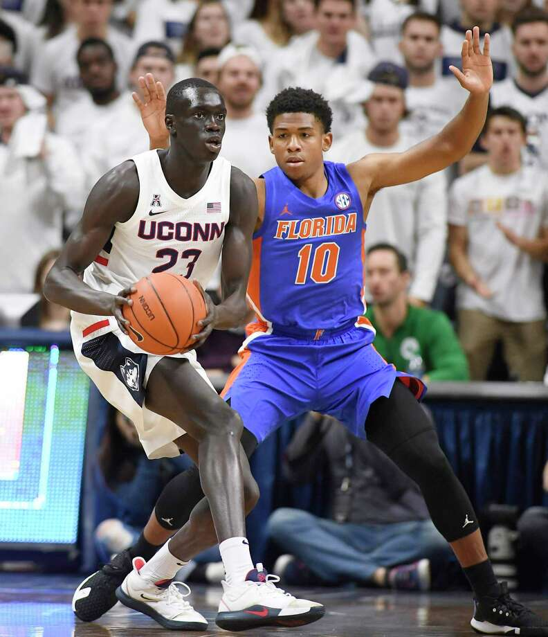 UConn's Akok Akok, left, is guarded by Florida's Noah Locke on Nov. 17. Photo: Jessica Hill / Associated Press / Copyright 2019 The Associated Press. All rights reserved