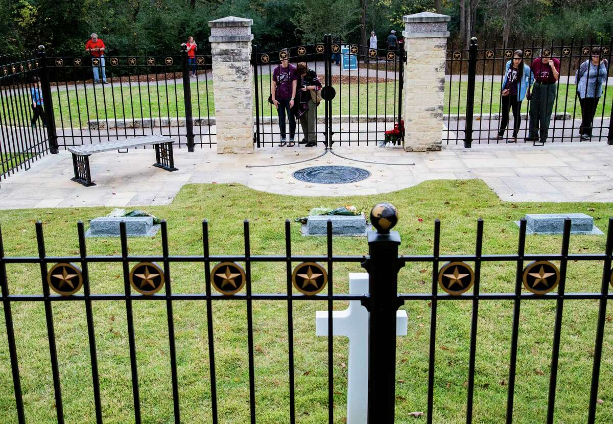 Visitors take a look at the Bush family burial site at the George H.W. Bush Presidential Library and Museum in College Station on Saturday, Nov. 30, 2019. Today is the first anniversary of the death of former President George H.W. Bush.