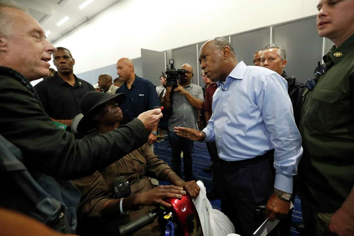 Mayor Sylvester Turner speaks to a reporter at the George R. Brown Convention Center, where the Red Cross had set up a shelter for those displaced by Tropical Storm Harvey, Friday, Sept. 1, 2017, in Houston. ( Karen Warren / Houston Chronicle )