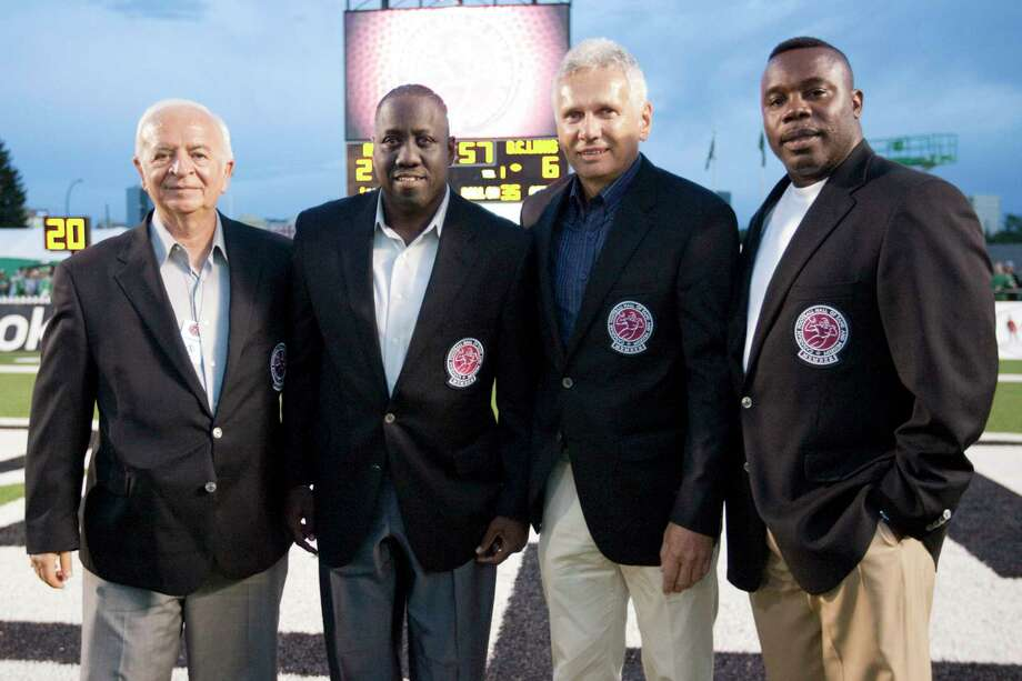 From left, 2010 CFL Hall of Fame inductees Joe Pistilli, Don Narcisse, Bob Cameron and Tracy Ham pose for a photo during the half time show at Mosaic Stadium on Thursday, Aug.12, 2010, in Regina, Saskatchewan. (AP Photo/The Canadian Press, Troy Fleece) Photo: Troy Fleece / ASSOCIATED PRESS / The Canadian Press