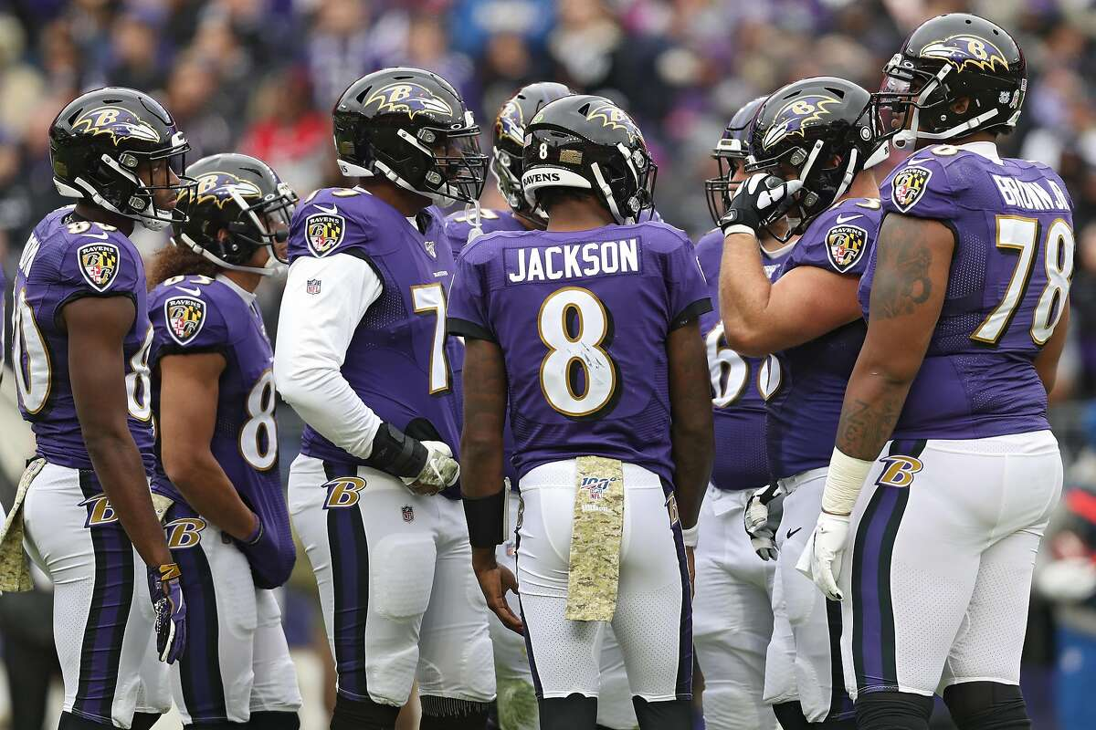ALTIMORE, MARYLAND - NOVEMBER 17: Quarterback Lamar Jackson #8 of the Baltimore Ravens stands in the muddle against the Houston Texans during the first quarter at M& Bank Stadium on November 17, 2019 in Baltimore, Maryland.