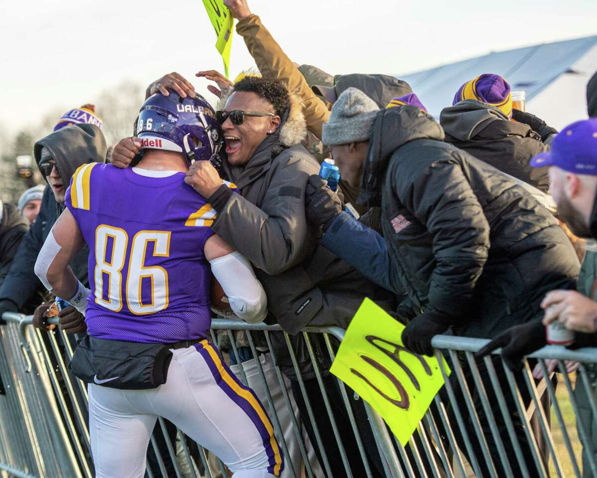 Fans congratulate UAlbany tight end LJ Wesneski after he caught a touchdown pass during a first round NCAA football playoff game against Central Connecticut at UAlbany on Saturday, Nov. 30, 2019 (Jim Franco/Special to the Times Union.)