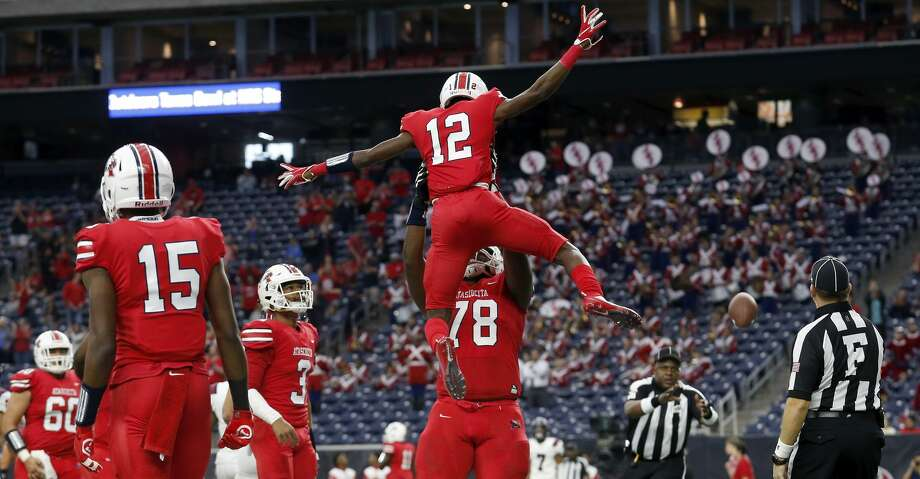 Atascocita Eagles Jer'Marques Bailey (78) lifts Keith Wheeler (12) after a touchdown reception during the first half of the high school football playoff game between the Tompkins Falcons and the Atascocita Eagles at NRG Stadium in Houston, TX on Saturday, November 30, 2019. The Eagles lead the Falcons 35-3 at halftime. Photo: Tim Warner/Contributor
