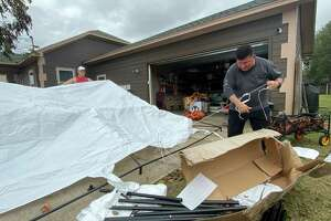 Eddie Ramirez prepares for a family Thanksgiving celebration that was postponed when he had to evacuate due to the TPC Group plant fire in Port Neches.