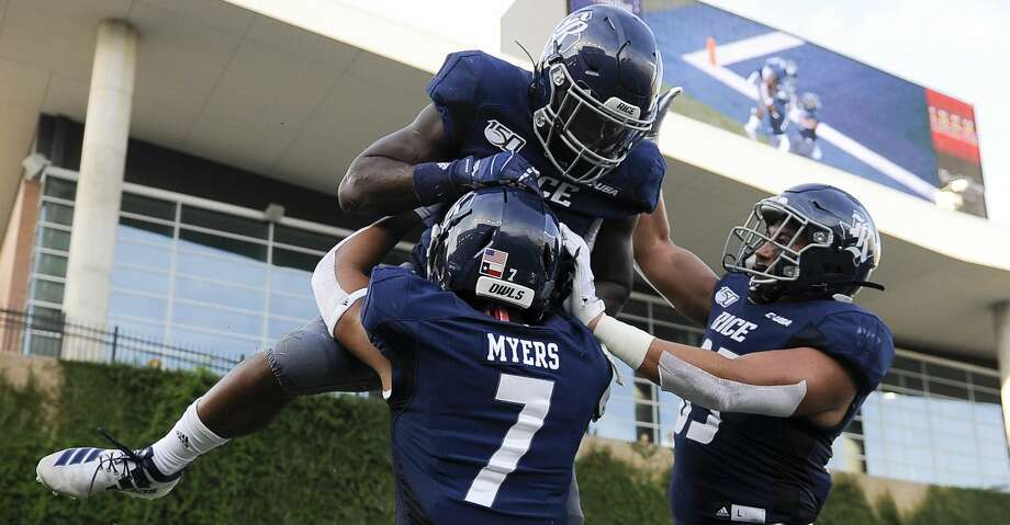 Rice running back Aston Walter, top, celebrates his touchdown with Jordan Myers (7) and Brendan Suckley during the first half of an NCAA college football game against Louisiana Tech , Saturday, Sept. 28, 2019, in Houston. Photo: Eric Christian Smith/Contributor