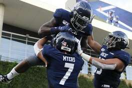 Rice running back Aston Walter, top, celebrates his touchdown with Jordan Myers (7) and Brendan Suckley during the first half of an NCAA college football game against Louisiana Tech , Saturday, Sept. 28, 2019, in Houston.