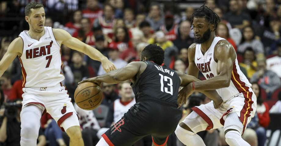 PHOTOS: Rockets game-by-game Miami Heat forward Justise Winslow (20) and guard Goran Dragic (7) guard Houston Rockets guard James Harden (13) during the fourth quarter of an NBA basketball game at the Toyota Center on Wednesday, Nov. 27, 2019, in Houston. Browse through the photos to see how the Rockets have fared in each game this season. Photo: Jon Shapley/Staff Photographer