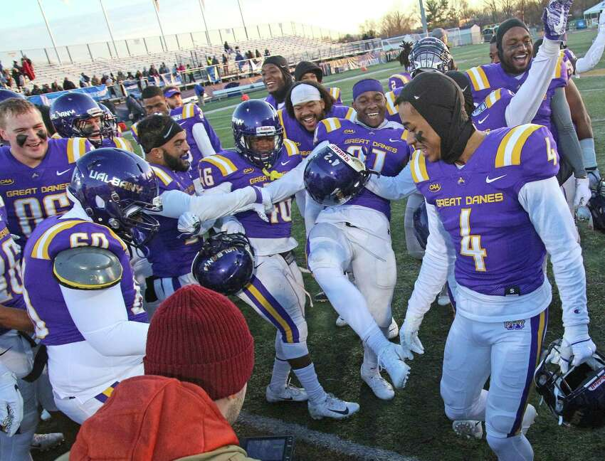 UAlbany football players dance in celebration after their 42-14 victory over over Central Connecticut State after the NCAA playoff at UAlbany on Nov. 30, 2019 in Albany, N.Y.