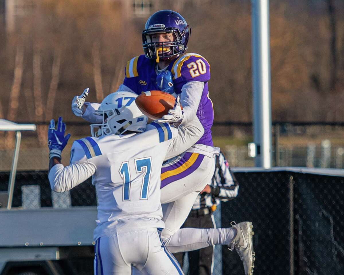 UAlbany receiver Tyler Oedekoven makes a one-handed touchdown catch around the back of Central Connecticut defensive back Kendall Coles during a first round NCAA football playoff game at UAlbany on Saturday, Nov. 30, 2019 (Jim Franco/Special to the Times Union.)