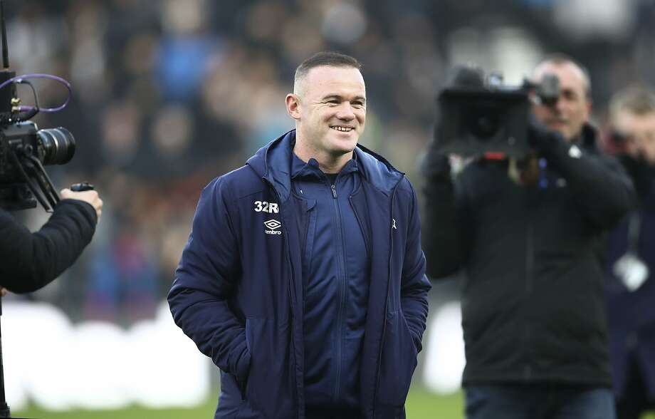 Former England star Wayne Rooney made his coaching debut at Derby County on Saturday. Photo: Tim Goode / Associated Press
