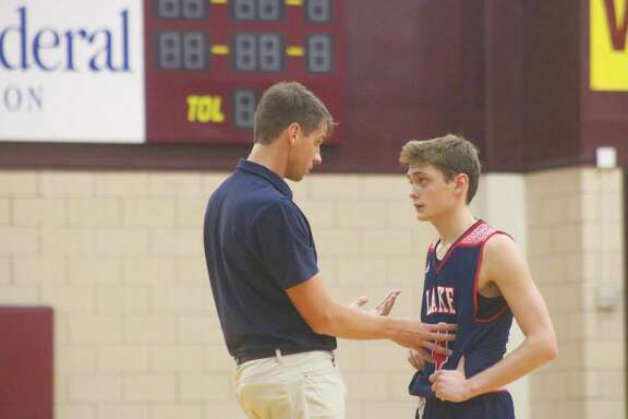 Clear Lake JV coach Matt Frye holds an unscheduled 1-on-1 conference with Aidan Wood during the Deer Park game on Friday. Although it wound up as a loss, Wood scored all of Lake's seven points in the fourth period. In the Morton Ranch game, he was 6-of-7 from the second-half foul line.