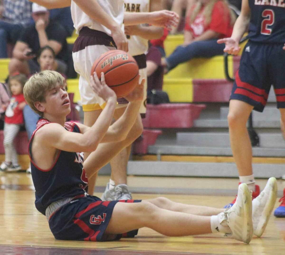Clear Lake's Josh Owens surrenders the basketball after he was called for a foul in the Deer Park contest on Friday.