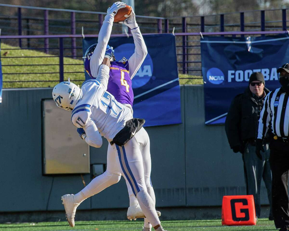 UAlbany receiver Juwan Green goes up to catch a touchdown pass in front of Central Connecticut defensive back Kendall Coles during the first round of the NCAA playoffs at UAlbany on Saturday, Nov. 30, 2019 (Jim Franco/Special to the Times Union.)