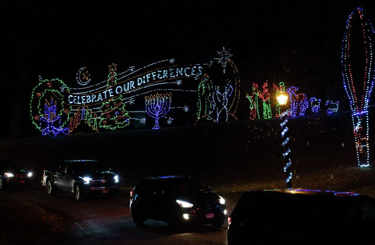 People drive through Washington Park to see the 23rd Annual Price Chopper/Market32 Capital Holiday Lights in the Park, which officially opened on Friday Nov. 29 and runs through Jan. 3, 2020. All proceeds benefit the Albany Police Athletic League programs. (Jim Franco/Special to the Times Union.)