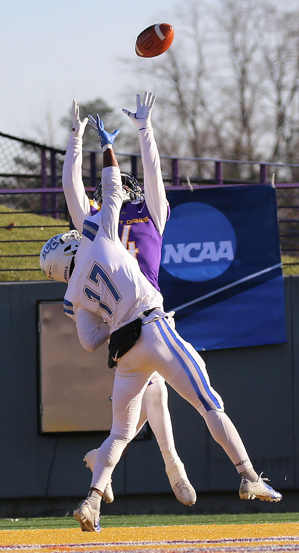 UAlbany receiver Juwan Green goes up to catch a touchdown pass in front of Central Connecticut defensive back Kendall Coles during the first round of the NCAA playoffs at UAlbany on Saturday, Nov. 30, 2019