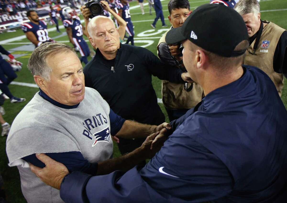 FOXBORO, MA - SEPTEMBER 22: Head coach Bill Belichick of the New England Patriots (L) shakes hands with head coach Bill O'Brien of the Houston Texans after the New England Patriots defeated the Houston Texans 27-0 at Gillette Stadium on September 22, 2016 in Foxboro, Massachusetts. (Photo by Adam Glanzman/Getty Images) ORG XMIT: 659054133