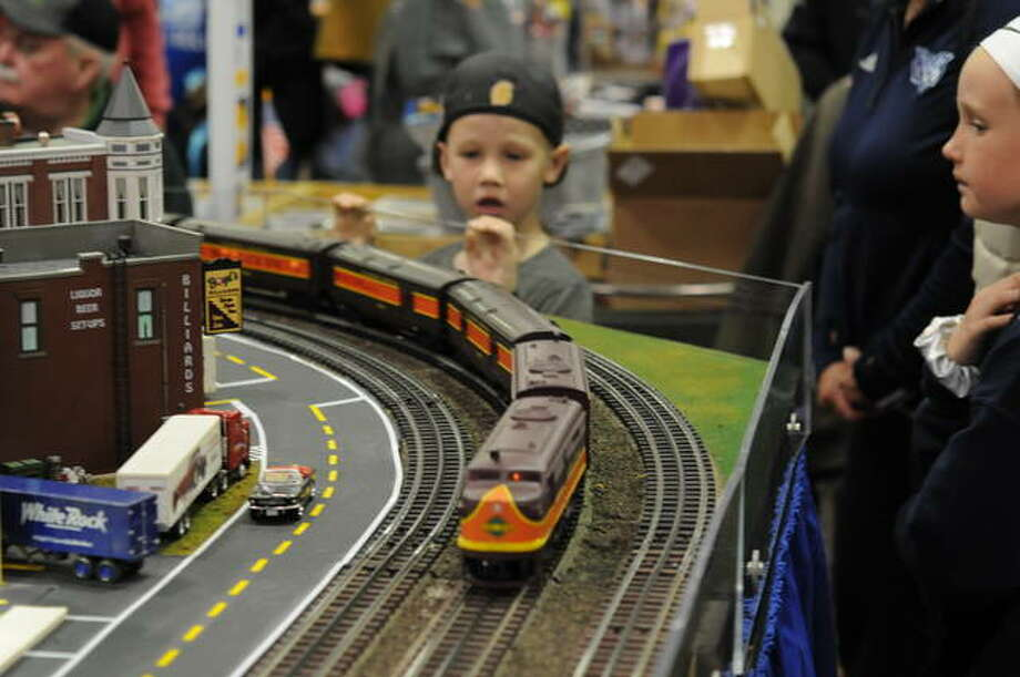 K.J. Trufant, 7, of Columbus, Mississippi, watches one of the layouts at the Great Train Expo. Photo: David Blanchette|For The Telegraph