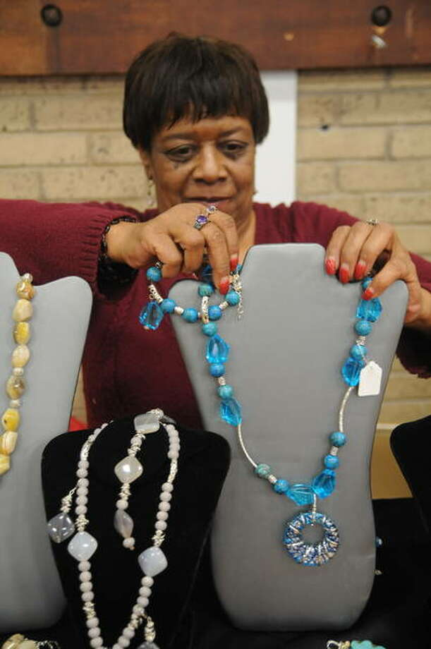 Designs by LaRue's LaRue LeSueur puts a custom-made necklace on display during Saturday's Black Expo. Photo: David Blanchette|For The Telegraph