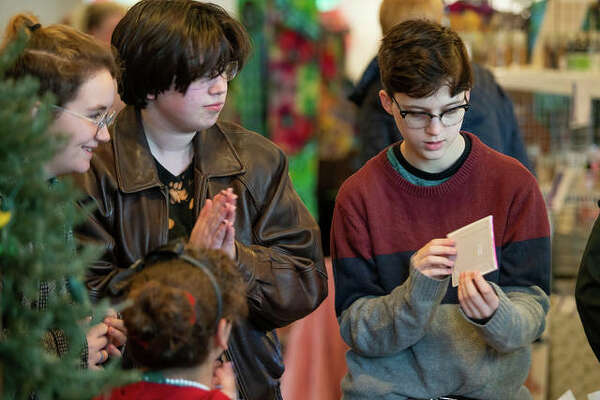 Kids interact with one of the 30 vendors Saturday at the Green Gift Bazaar, held at Post Commons in Alton. The event, co-sponsored by Alton Main Street and the Sierra Club, saw more than 1,000 guests peruse local handmade art and crafts.