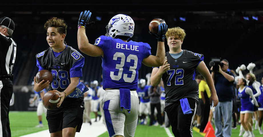 Katy Taylor senior running back Gavin Belue (33) celebrates his touchdown catch which gave the Mustangs a 14-0 lead early in the second quarter of their Region III-6A semi-final matchup at NRG Stadium on Saturday, Nov. 30, 2019. Photo: Jerry Baker/Contributor