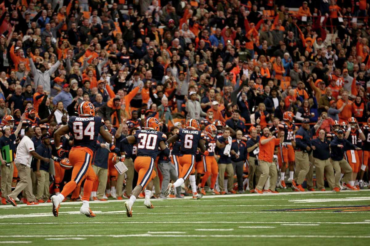 SYRACUSE, NEW YORK - NOVEMBER 30: Trill Williams #6 of the Syracuse Orange runs with the ball after stripping the ball from Kendall Hinton #2 of the Wake Forest Demon Deacons during overtime at the Carrier Dome on November 30, 2019 in Syracuse, New York. (Photo by Bryan M. Bennett/Getty Images)