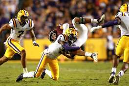BATON ROUGE, LOUISIANA - NOVEMBER 30: Kary Vincent Jr. #5 of the LSU Tigers tackles Kellen Mond #11 of the Texas A&M Aggies during a game at Tiger Stadium on November 30, 2019 in Baton Rouge, Louisiana. (Photo by Sean Gardner/Getty Images)