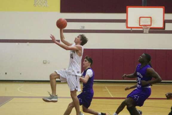 With three Morton Ranch defenders chasing him, Clear Creek's David Dry scores the dramatic winning bucket as time expires, completing the Wildcats' miracle rally from 15 points down in the game's final minutes.