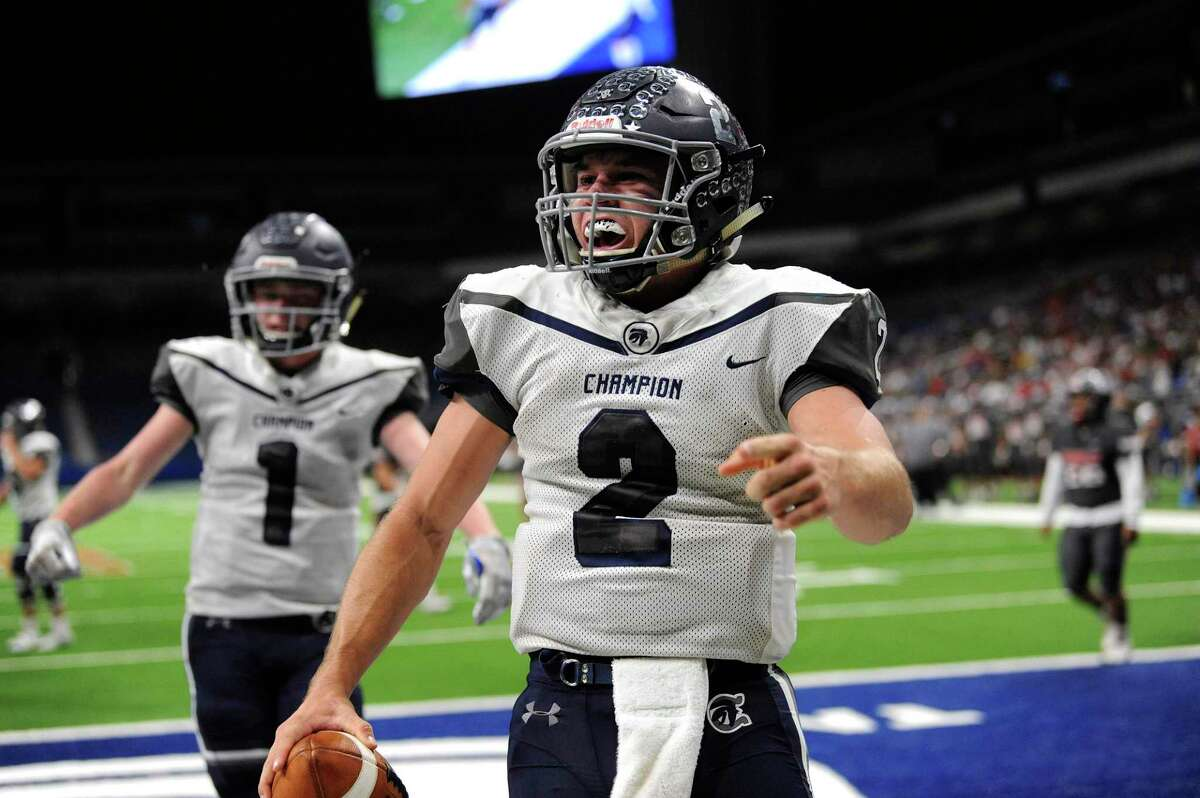 Boerne Champion quarterback Luke Boyers celebrates a first-half run for touchdown against Sharyland Pioneer during Region IV-5A semifinal football action in the Alamodome on Saturday, Nov. 30, 2019. Boerne Champion won in overtime, 45-38.