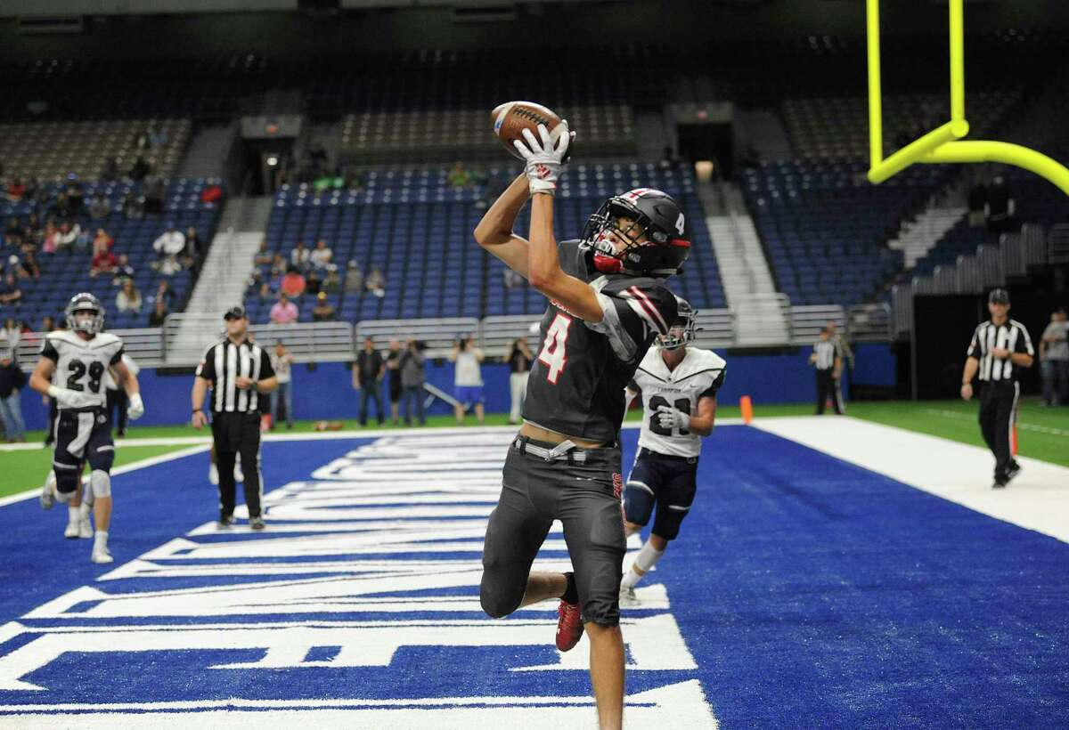 Sharyland Pioneer's Allen Davila catches a pass to complete a two-point conversion, tying the game at 38 late in the fourth quarter during Region IV-5A semifinal football action against Boerne Champion in the Alamodome on Saturday, Nov. 30, 2019.