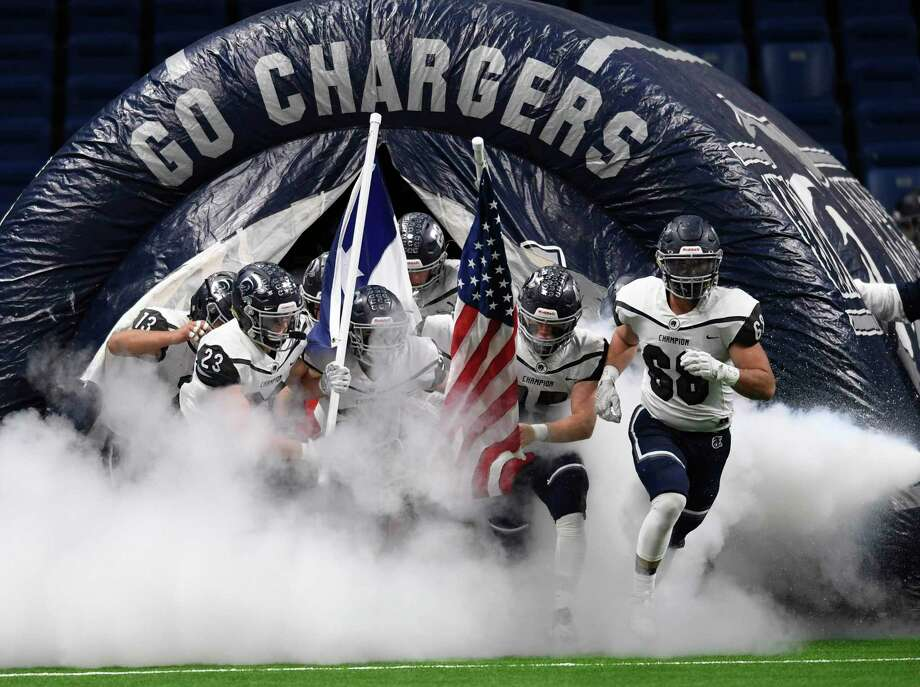 The Boerne Champion Chargers enter the Alamodome field for their Region IV-5A semifinal football game against Sharyland Pioneer on Saturday, Nov. 30, 2019. Photo: Billy Calzada /Staff Photographer / ***MANDATORY CREDIT FOR PHOTOG AND SAN ANTONIO EXPRESS-NEWS /NO SALES/MAGS OUT/TV