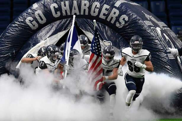 The Boerne Champion Chargers enter the Alamodome field for their Region IV-5A semifinal football game against Sharyland Pioneer on Saturday, Nov. 30, 2019.