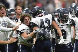The Boerne Champion Chargers celebrate their 45-38 victory over Sharyland Pioneer in Region IV-5A semifinal football action in the Alamodome on Saturday, Nov. 30, 2019.