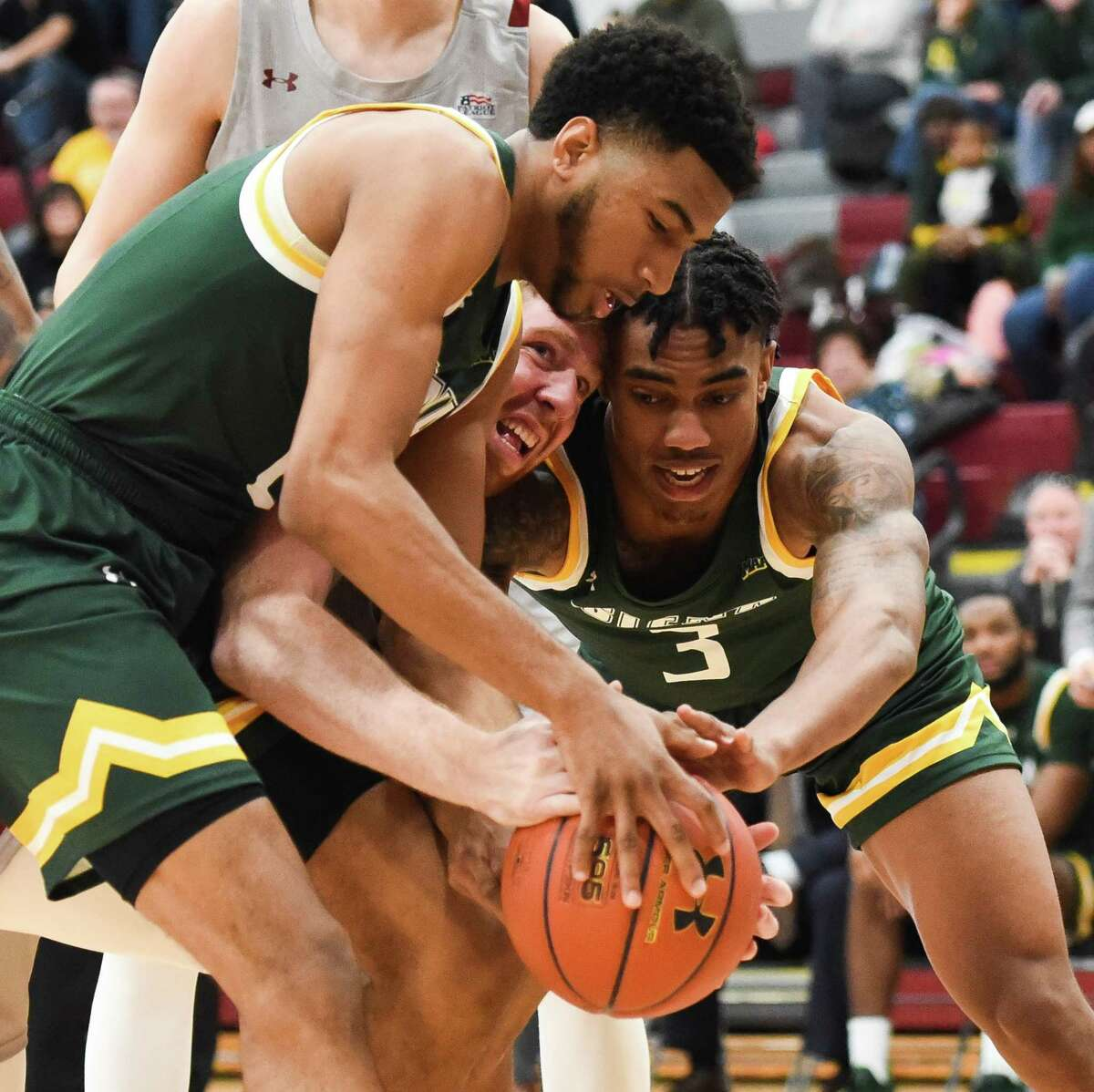 Colgate player Will Rayman, center, fights for control of the ball with multiple Siena defenders on Saturday, Nov. 30, 2019 at Colgate University. Colgate won 72-62. (Alex Cooper / Utica Observer-Dispatch)
