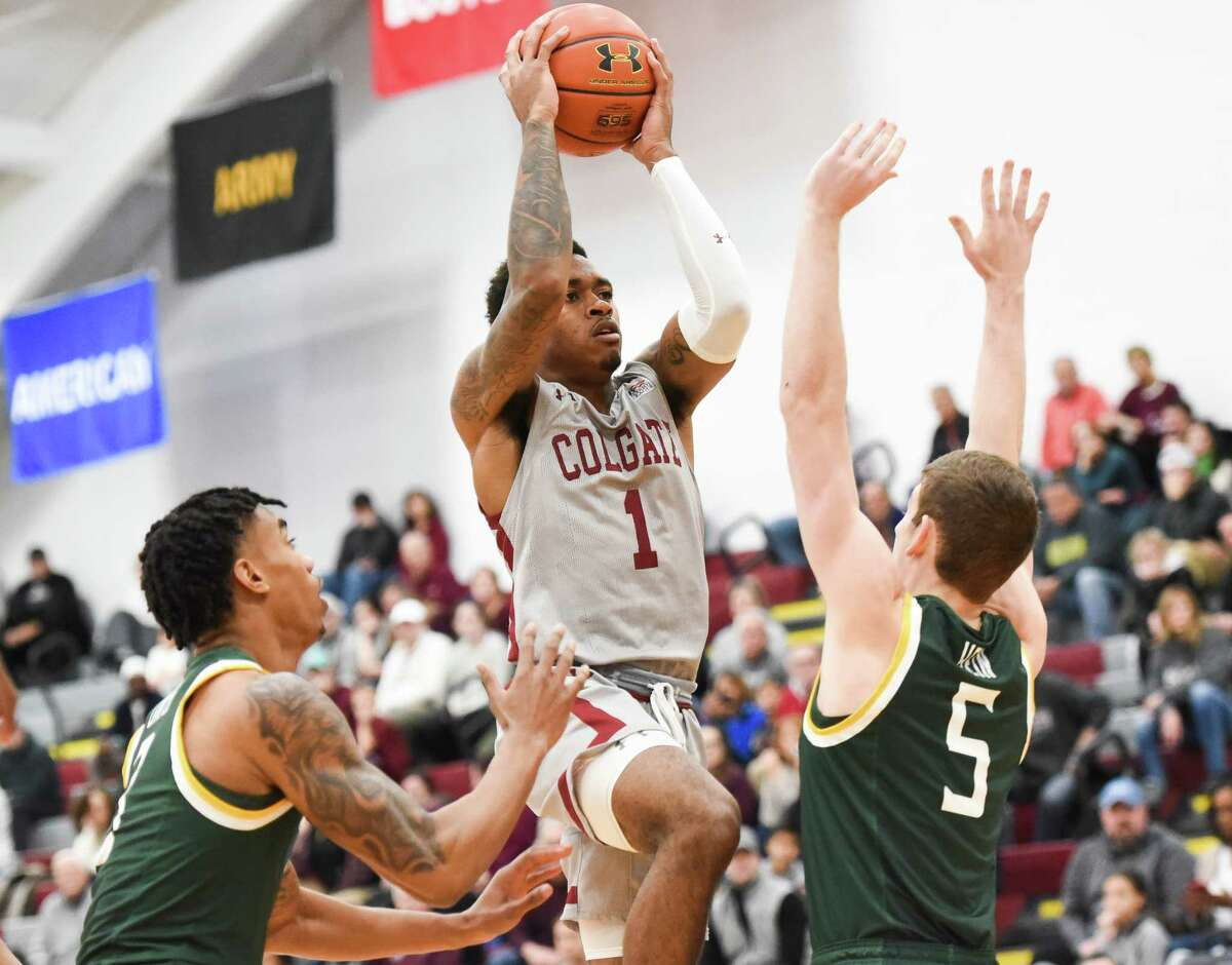 Colgate player Jordan Burns attempts to shoot a layup as Siena players Manny Camper, left, and Matt Hein defend during the game on Saturday, Nov. 30, 2019, at Colgate University. Colgate won 72-62. (Alex Cooper / Utica Observer-Dispatch)