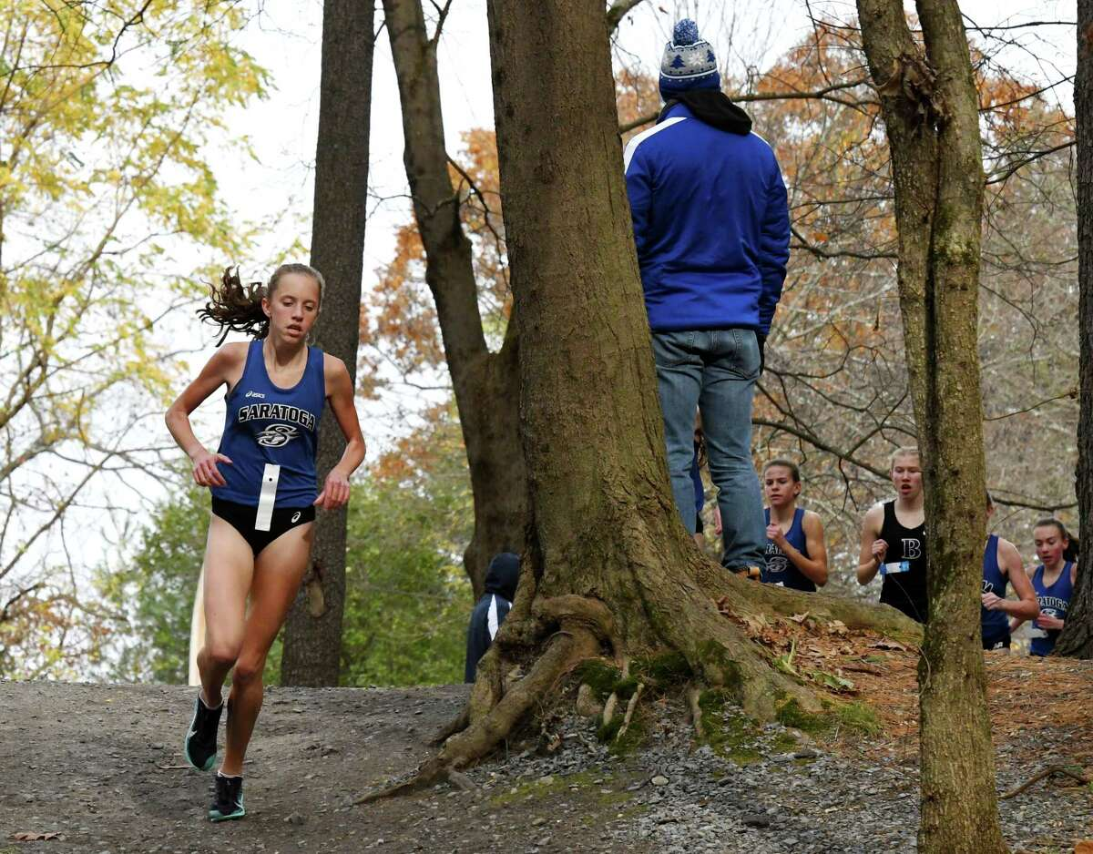 Ella Kurto of Saratoga leads the pack through Saratoga Spa State Park to to win the Class A girls' Section II Cross Country Championships race on Monday, Nov. 4, 2019, in Saratoga Springs, N.Y. (Will Waldron/Times Union)