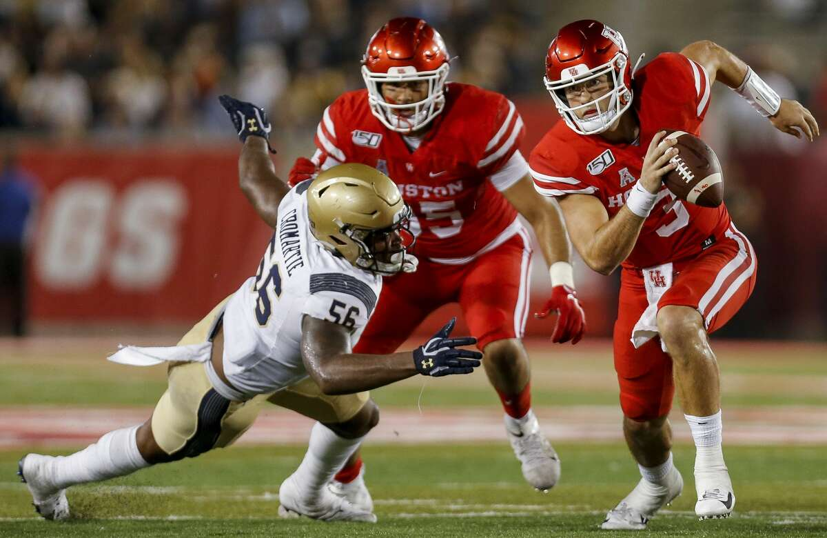 Houston Cougars quarterback Clayton Tune (3) scrambles out of the pocket against the Navy Midshipmen during the fourth quarter of an NCAA game at TDECU Stadium Saturday, Nov. 30, 2019, in Houston. Navy won 56-41.