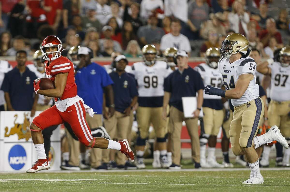 Houston Cougars wide receiver Tre'von Bradley (81) scores a 67-yard receiving touchdown against the Navy Midshipmen during the first quarter of an NCAA game at TDECU Stadium Saturday, Nov. 30, 2019, in Houston.