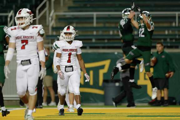 The Woodlands defensive back Kennedy Stewart (1) reacts as Prosper quarterback Jackson Berry (5) and wide receiver Hayden Metcalf (12) celebrate their 13-yard touchdown during the third quarter of a Region II-6A semifinal high school football playoff game at McLane Stadium, Saturday, Nov. 30, 2019, in Waco.