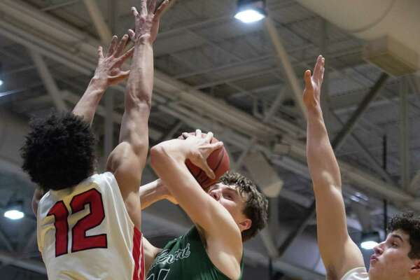 Albany Academy's Marcus Jackson (12) and James Thompson (30) block a shot by Schalmont's Shane O'Dell during a game on Saturday, Nov. 30, 2019, at SEFCU Arena in Albany, N.Y. (Jenn March, Special to the Times Union)