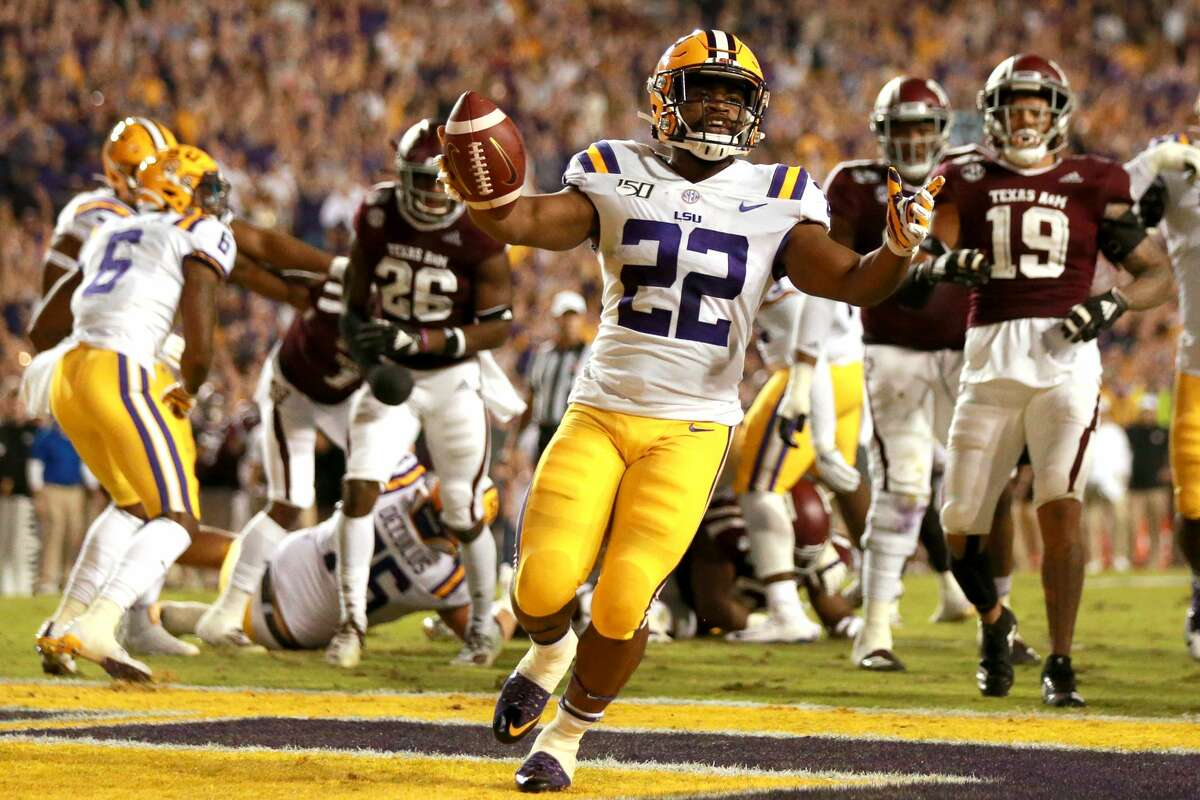 BATON ROUGE, LOUISIANA - NOVEMBER 30: Clyde Edwards-Helaire #22 of the LSU Tigers reacts after scoring a toucdown during a game against the Texas A&M Aggies at Tiger Stadium on November 30, 2019 in Baton Rouge, Louisiana. (Photo by Sean Gardner/Getty Images)
