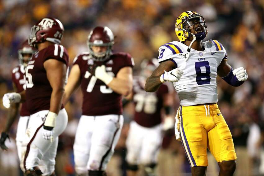 BATON ROUGE, LOUISIANA - NOVEMBER 30: Patrick Queen #8 of the LSU Tigers reacts after a play during a game against the Texas A&M Aggies at Tiger Stadium on November 30, 2019 in Baton Rouge, Louisiana. (Photo by Sean Gardner/Getty Images)