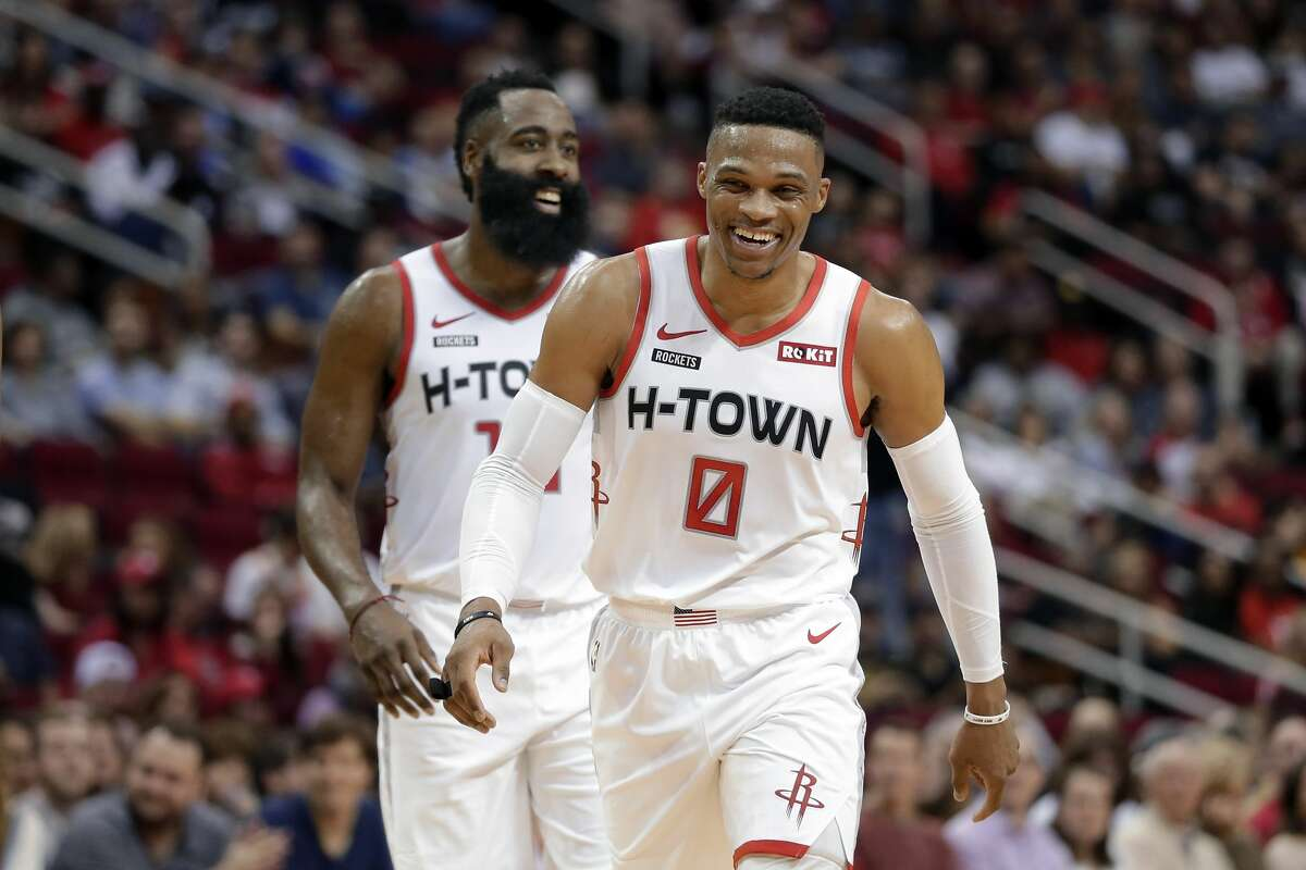 Houston Rockets guards Russell Westbrook (0) and James Harden, behind, laugh after a score against the Atlanta Hawks during the second half of an NBA basketball game, Saturday, Nov. 30, 2019, in Houston. (AP Photo/Michael Wyke)