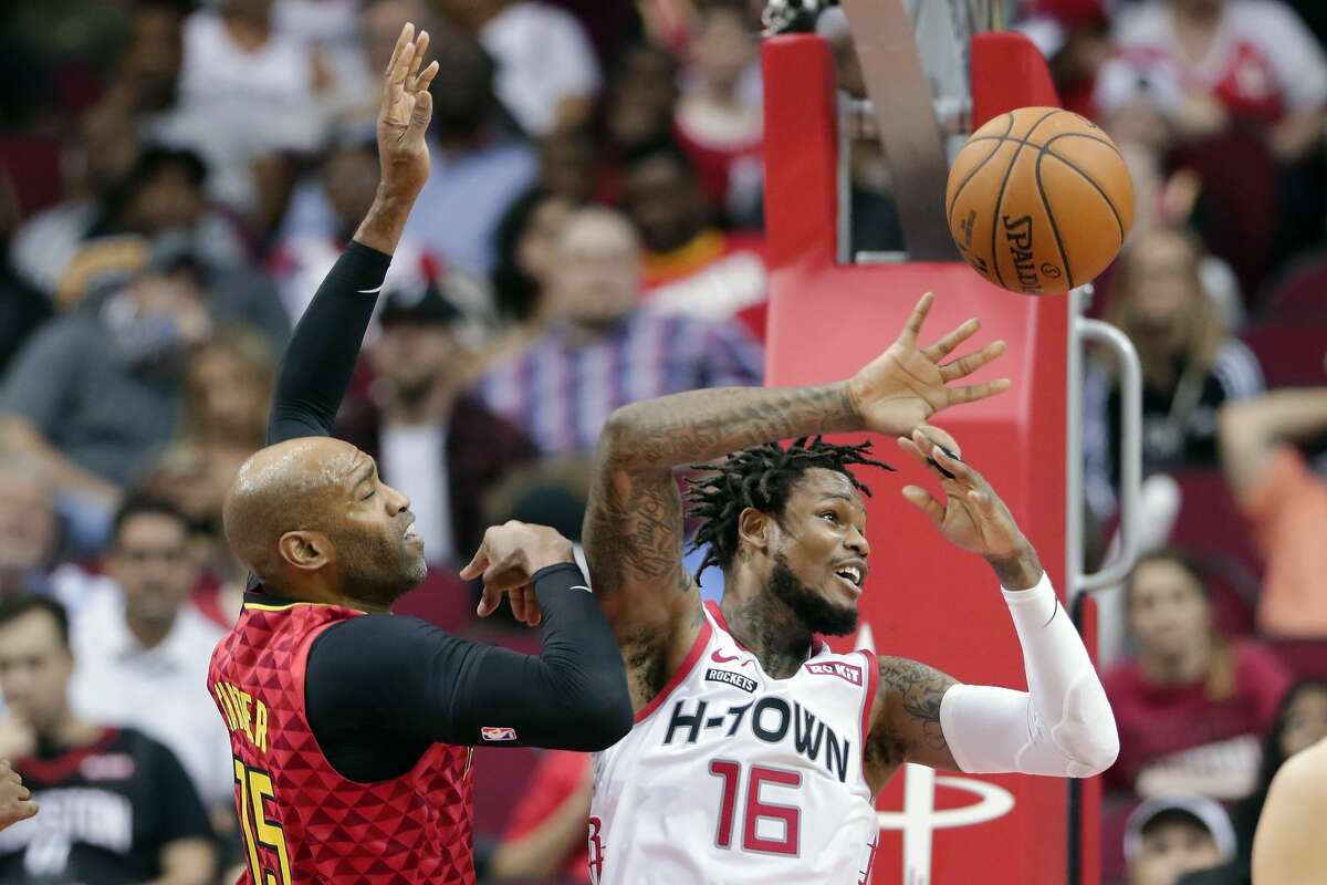 Houston Rockets guard Ben McLemore (16) loses a rebound in front of Atlanta Hawks guard Vince Carter (15) during the second half of an NBA basketball game, Saturday, Nov. 30, 2019, in Houston. (AP Photo/Michael Wyke)